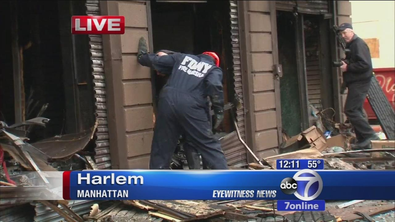 Authorities looking for cause of fire that damaged Harlem store, apartments