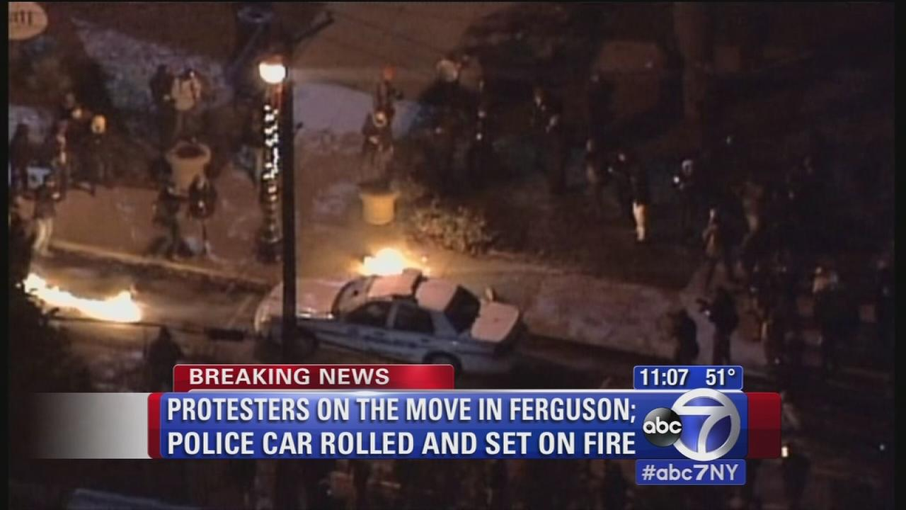 Protesters set car on fire in Ferguson, officer speaks out
