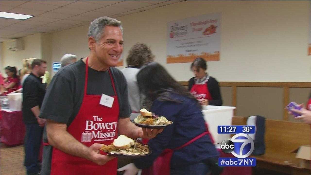 Bill Ritter and Rob Powers serve Thanksgiving dinner at The Bowery Mission