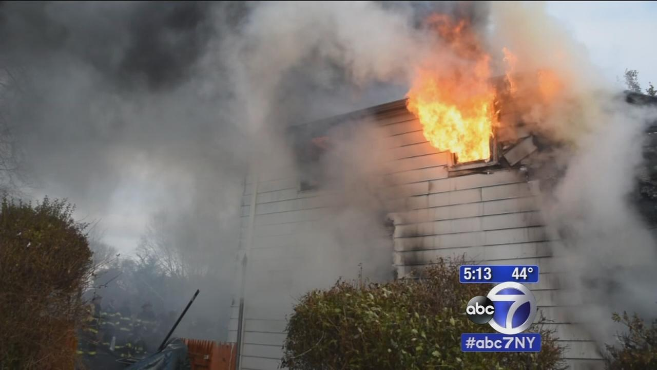 Woman dies in fire after going back inside for cats