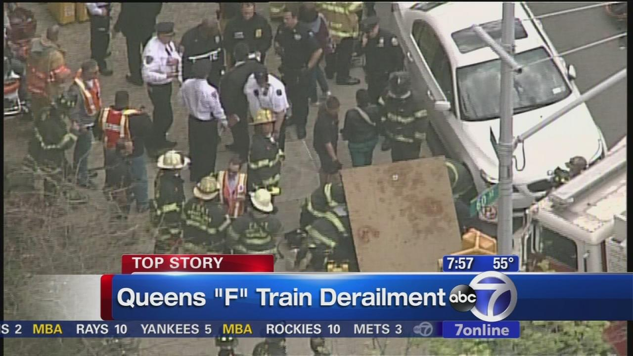 Subway service partially suspended by Queens derailment