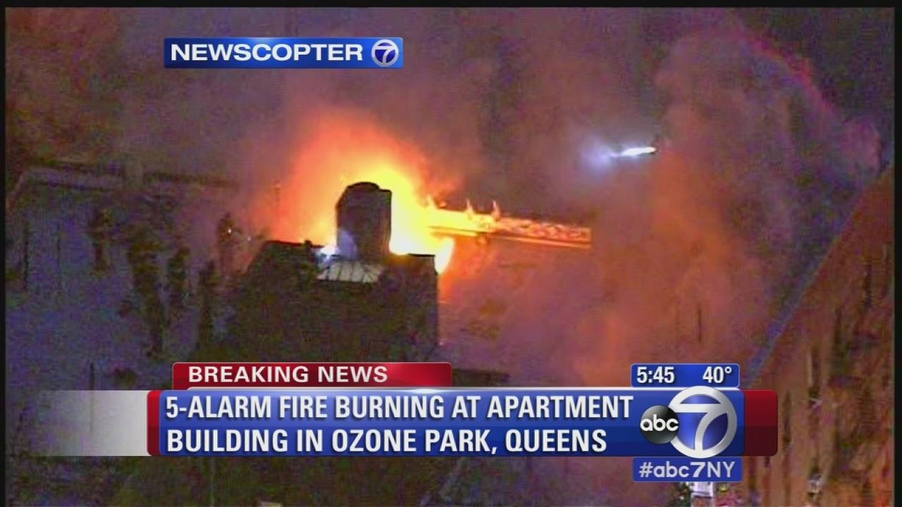 Firefighters battle 5-alarm fire at Queens apartment building causing traffic
