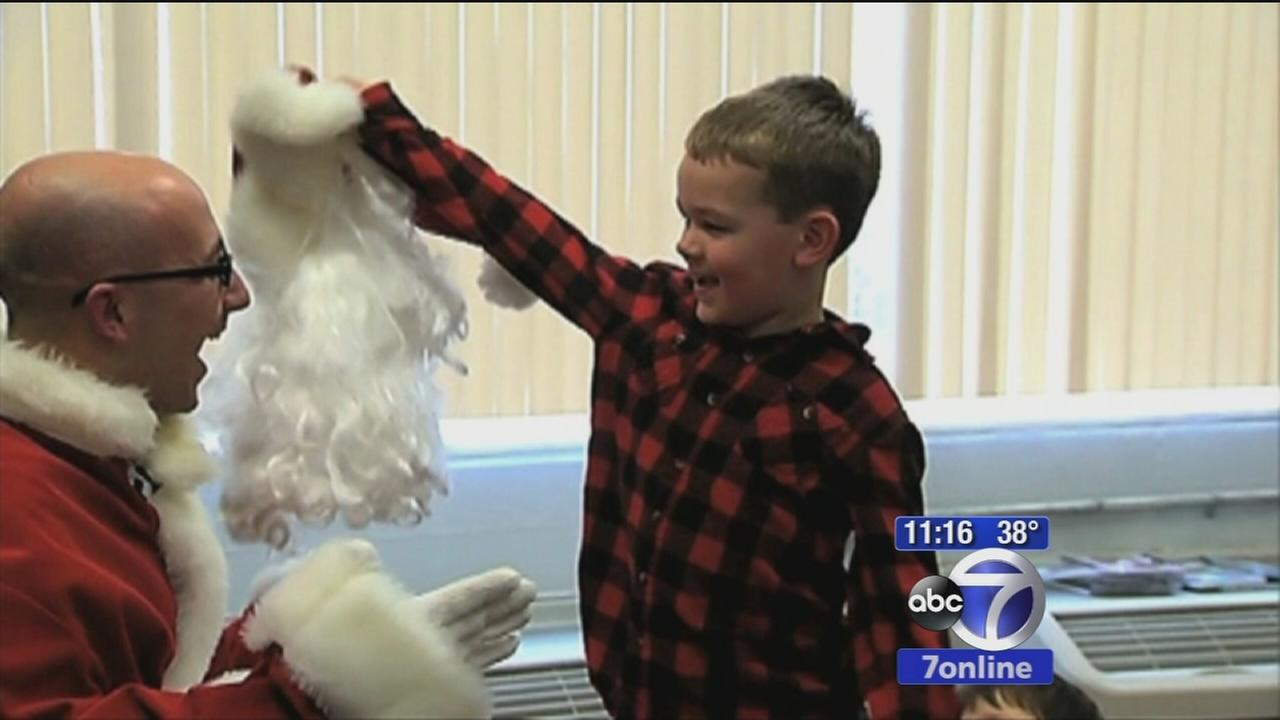 Boy gets Santa surprise from airman dad