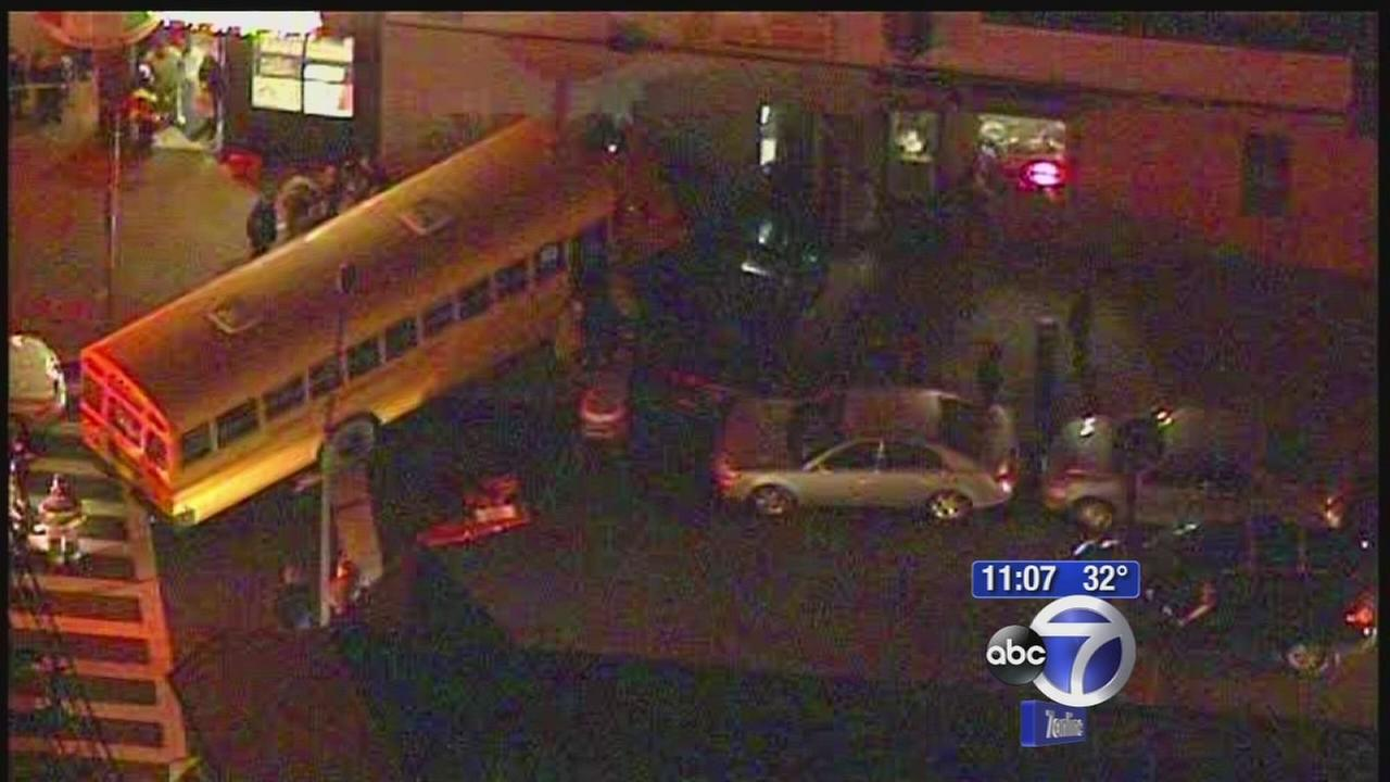 Several injured when school bus crashes into Woodside building