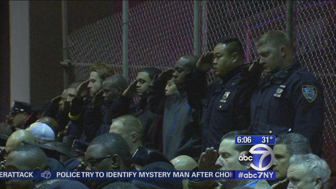 Fellow officers salute 2 fallen cops