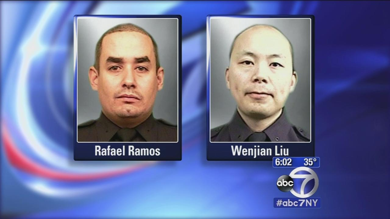 City reeling from murders of 2 police officers