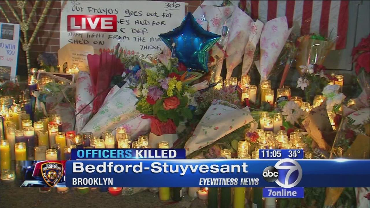 Candlelight vigil held for slain officers