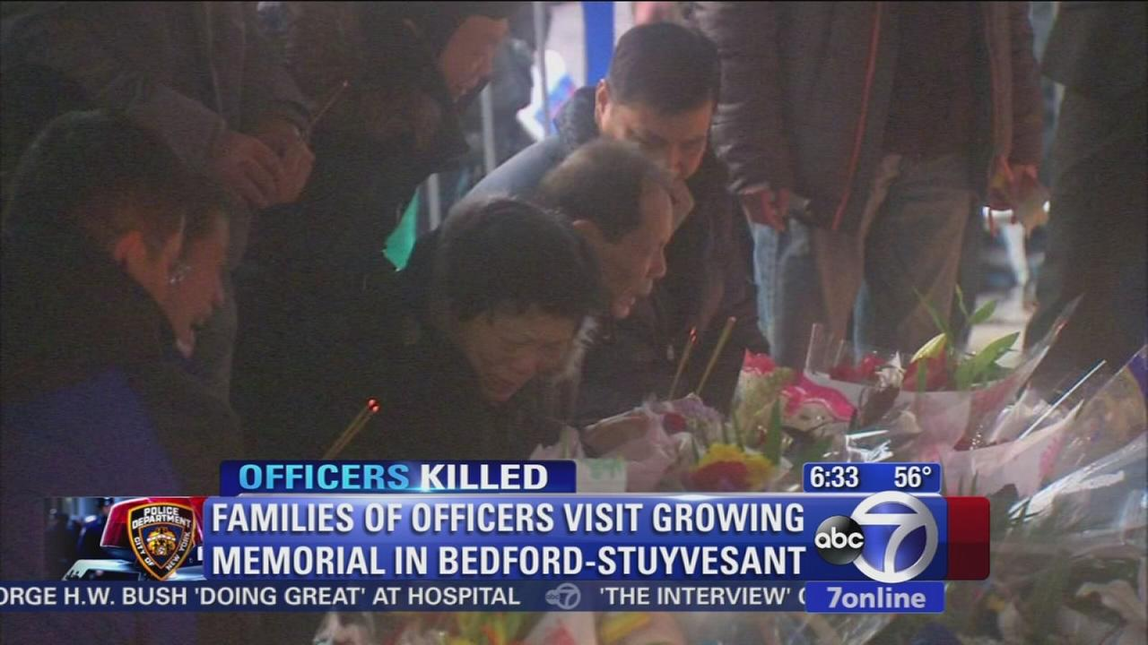 Mourners visit scene of officer shootings