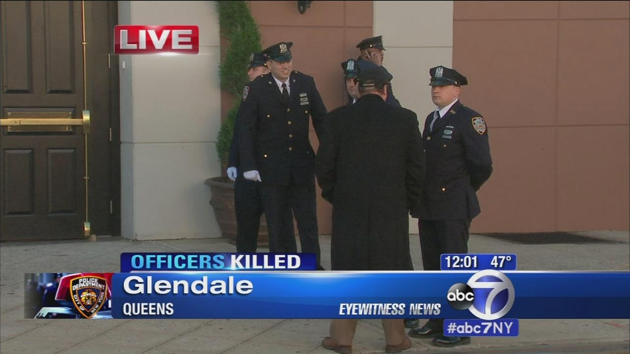 Honor Guard awaits casket of fallen NYPD officer; organization to pay widows mortgage