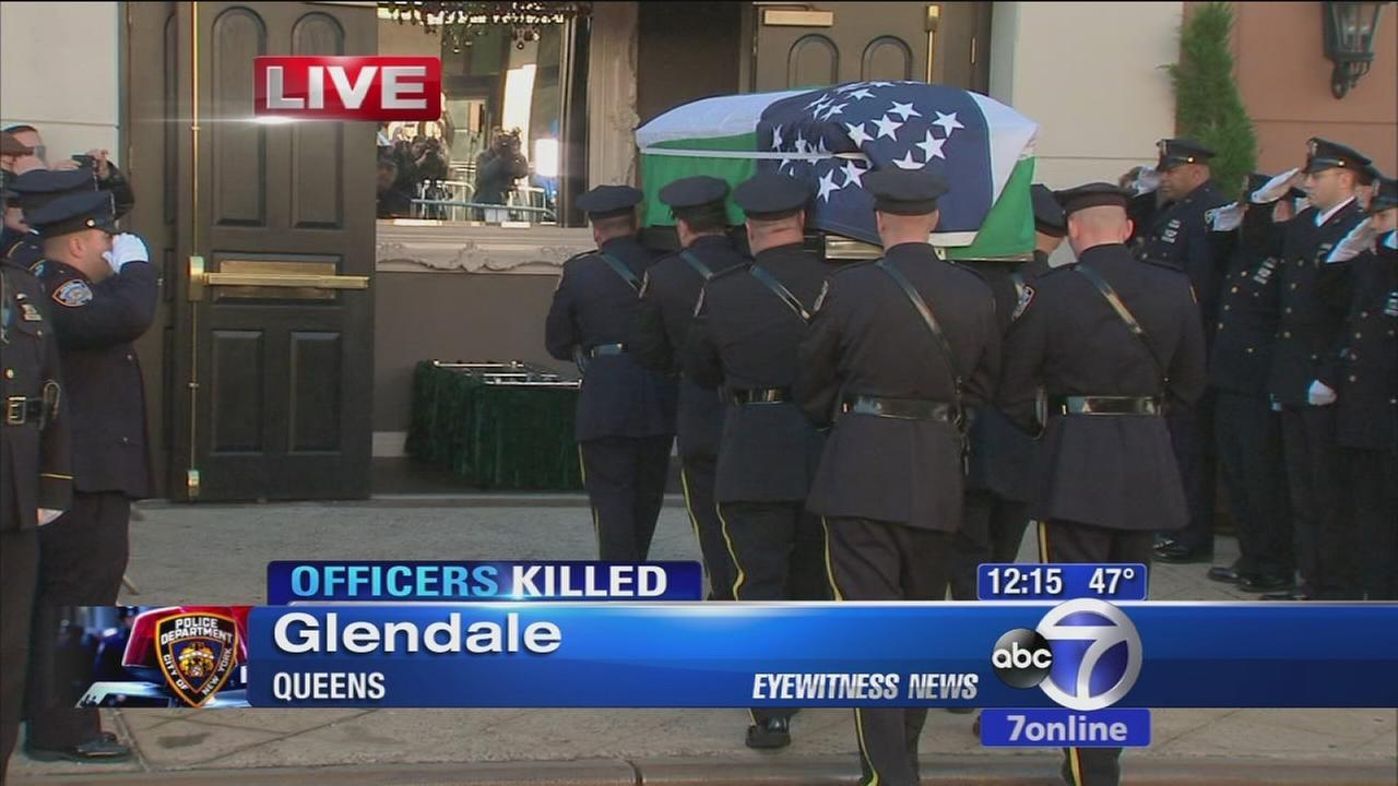 VIDEO: Casket of Rafael Ramos is brought into church
