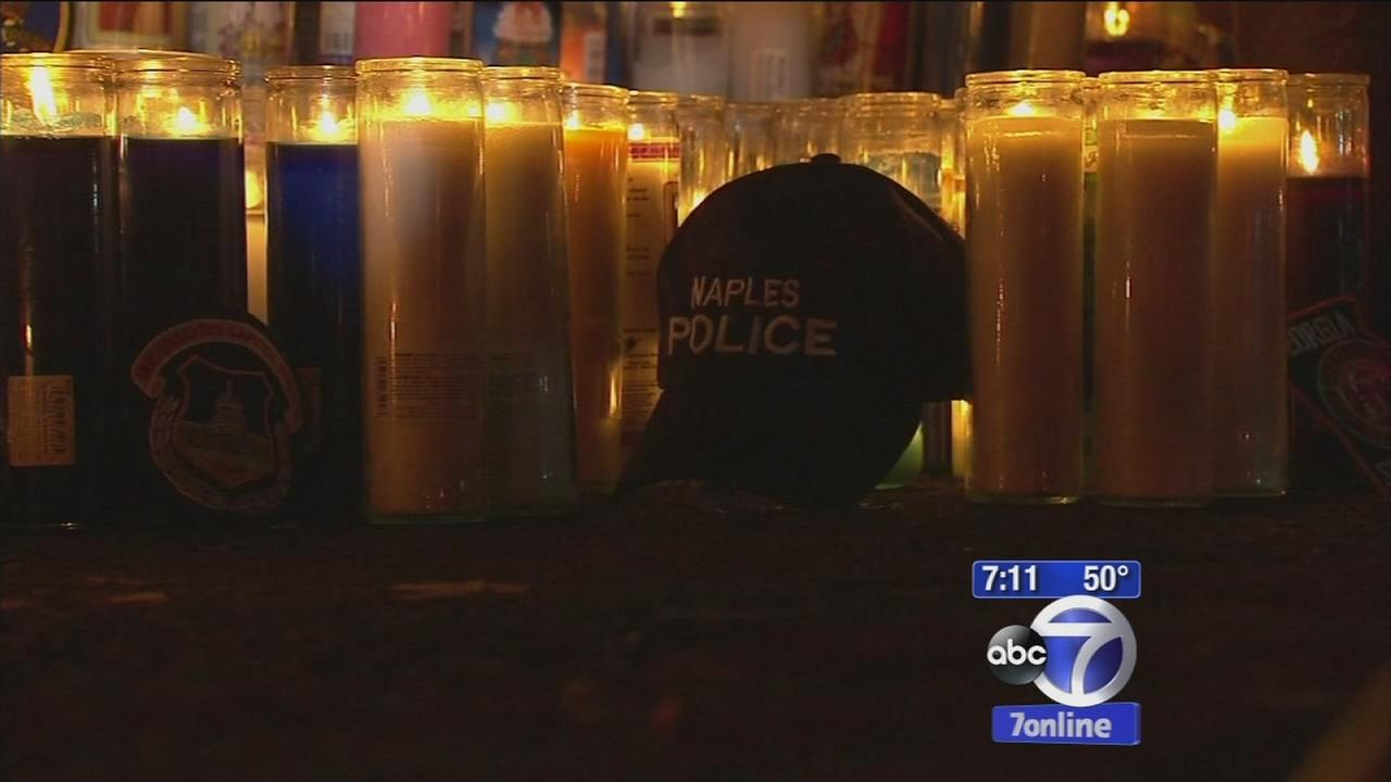 New Yorkers continue to pay respects to fallen officers at growing memorial