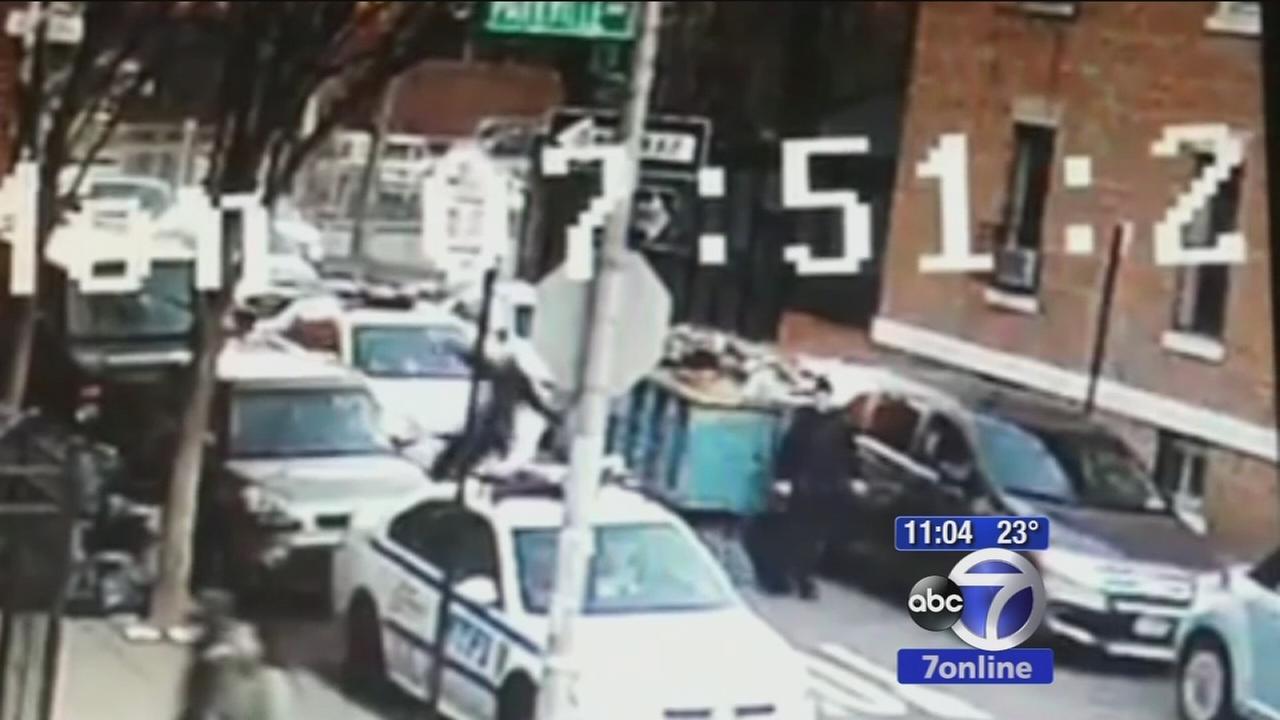 Police officer flies off hood of police cruiser