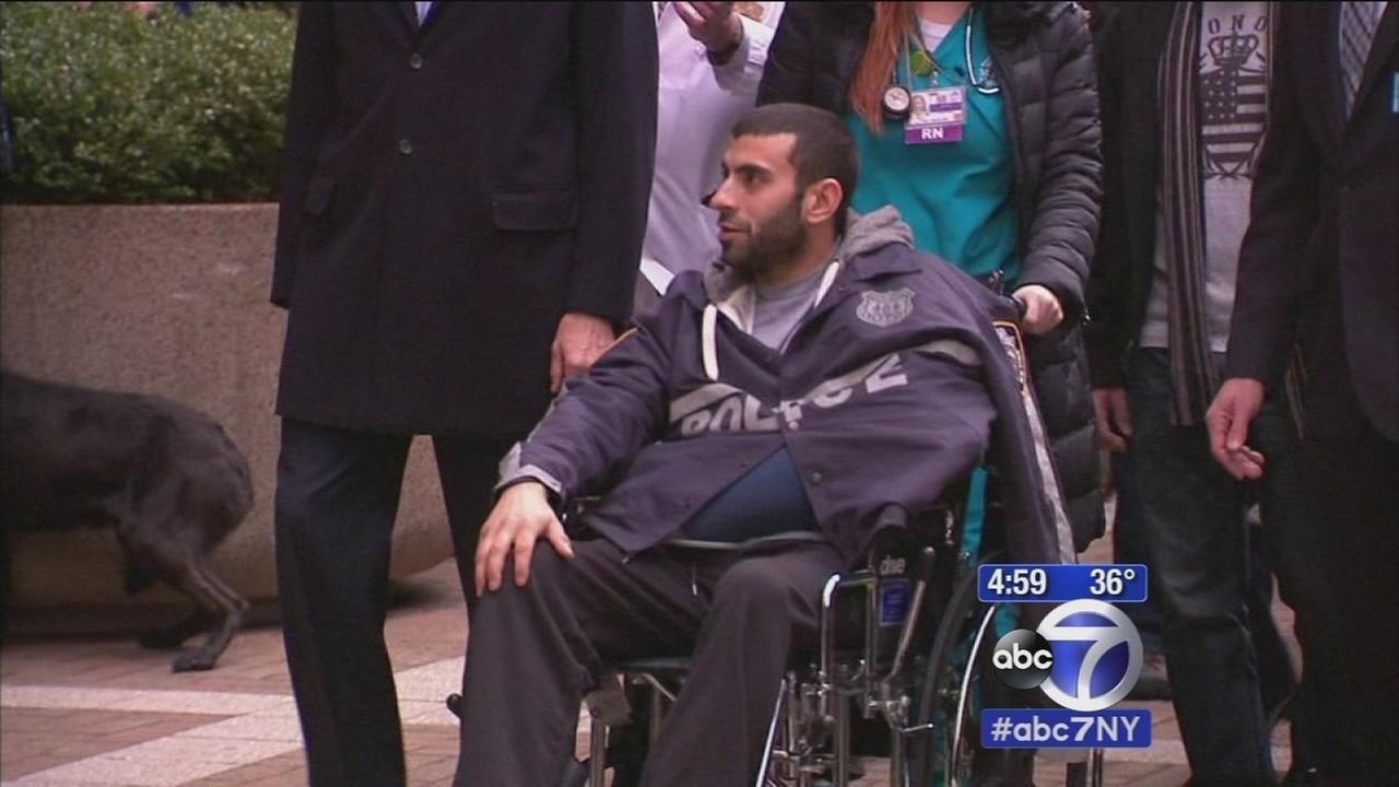 Wounded officer heads home from hospital