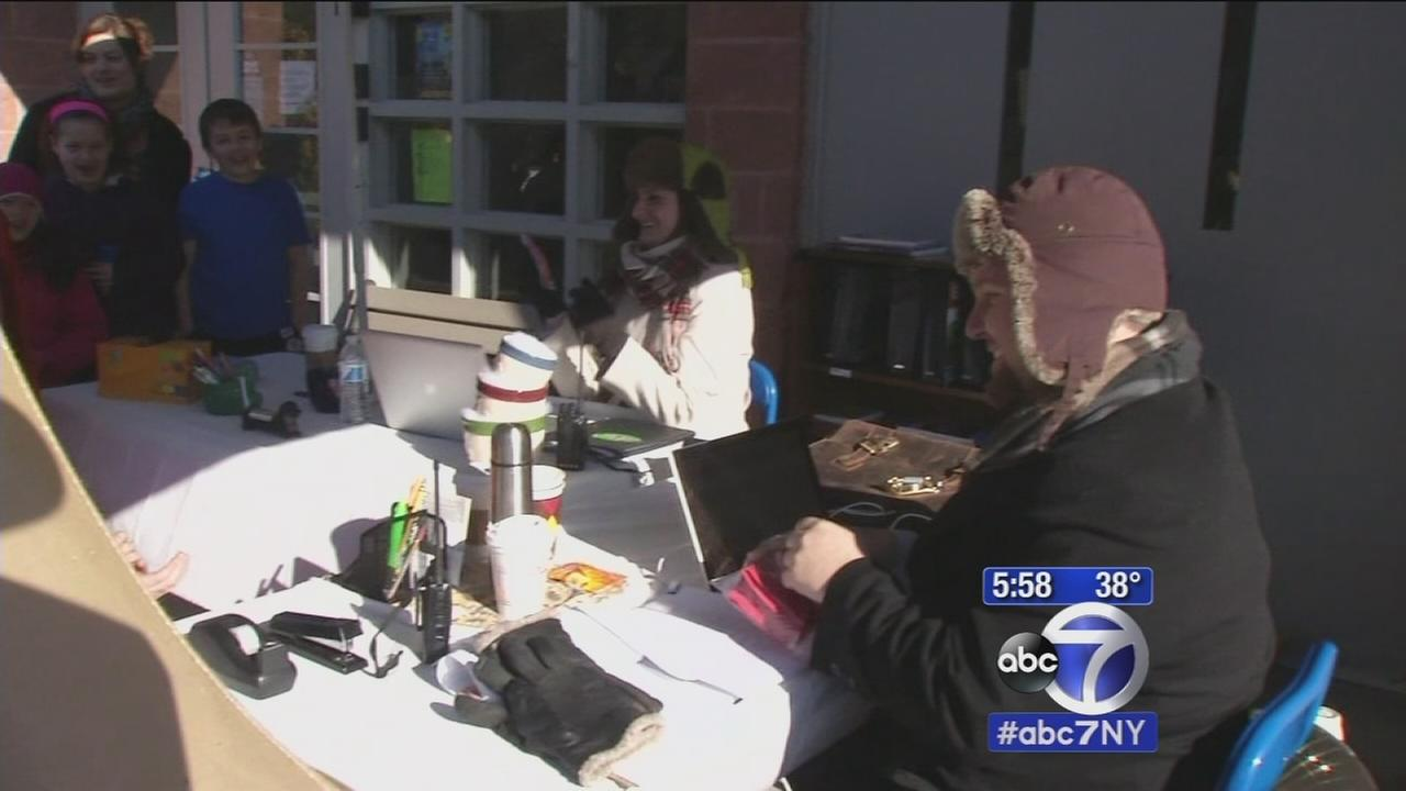 School Administration spends days outside after students beat reading goal