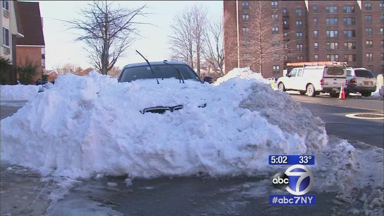 City residents battle to dig their cars out of snow