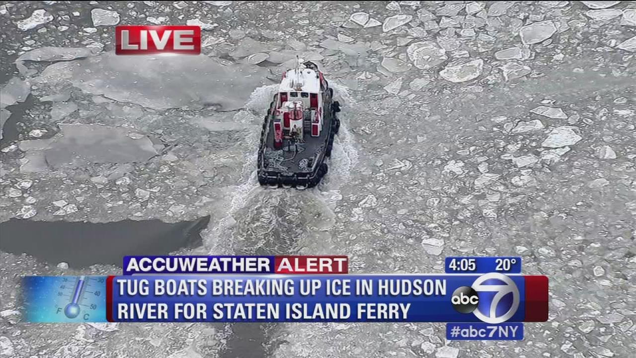 Tug boats breaking up ice in Hudson River for Staten Island Ferry