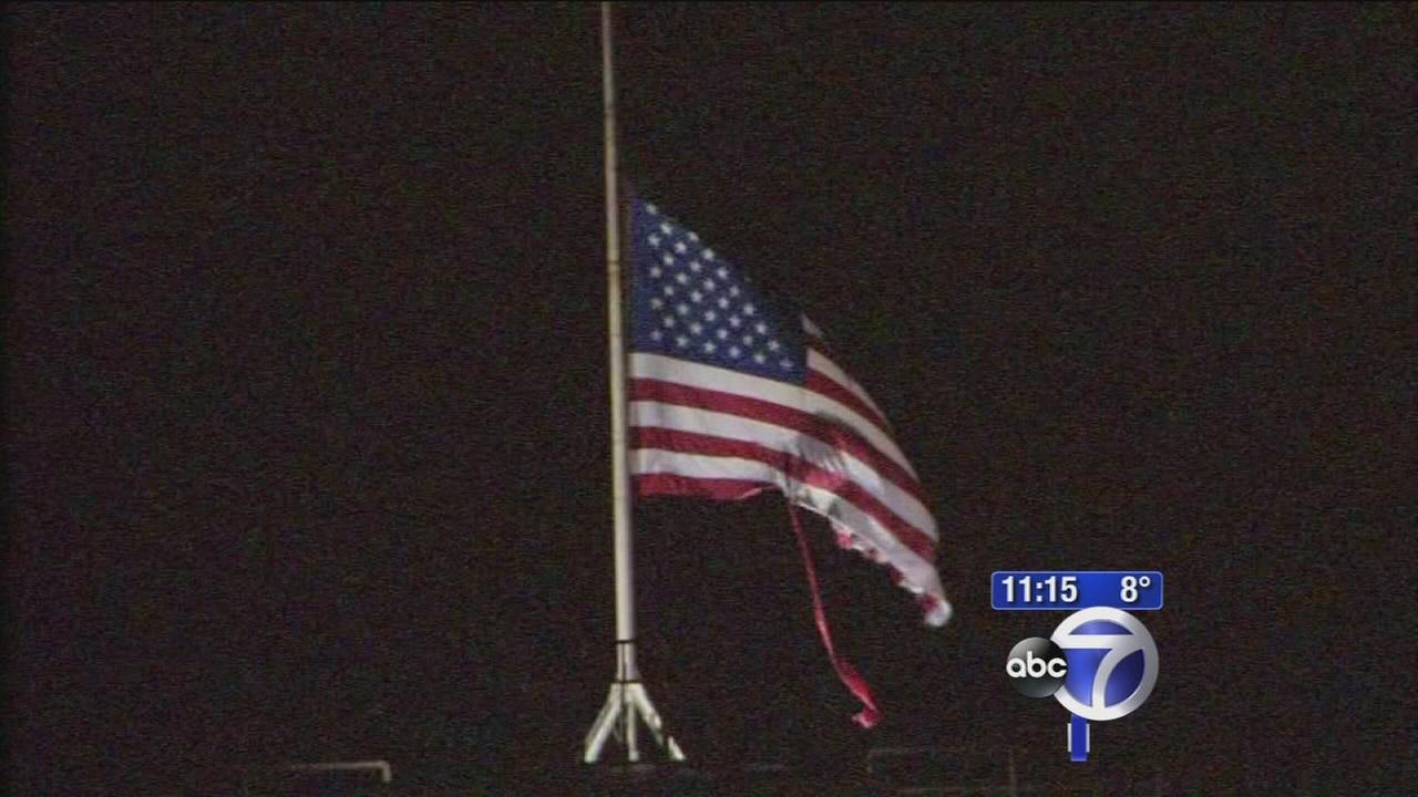 Brutal winter batters American flags on Brooklyn Bridge