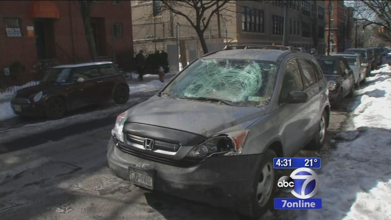 Huge chunk of snow smashes through drivers windshield