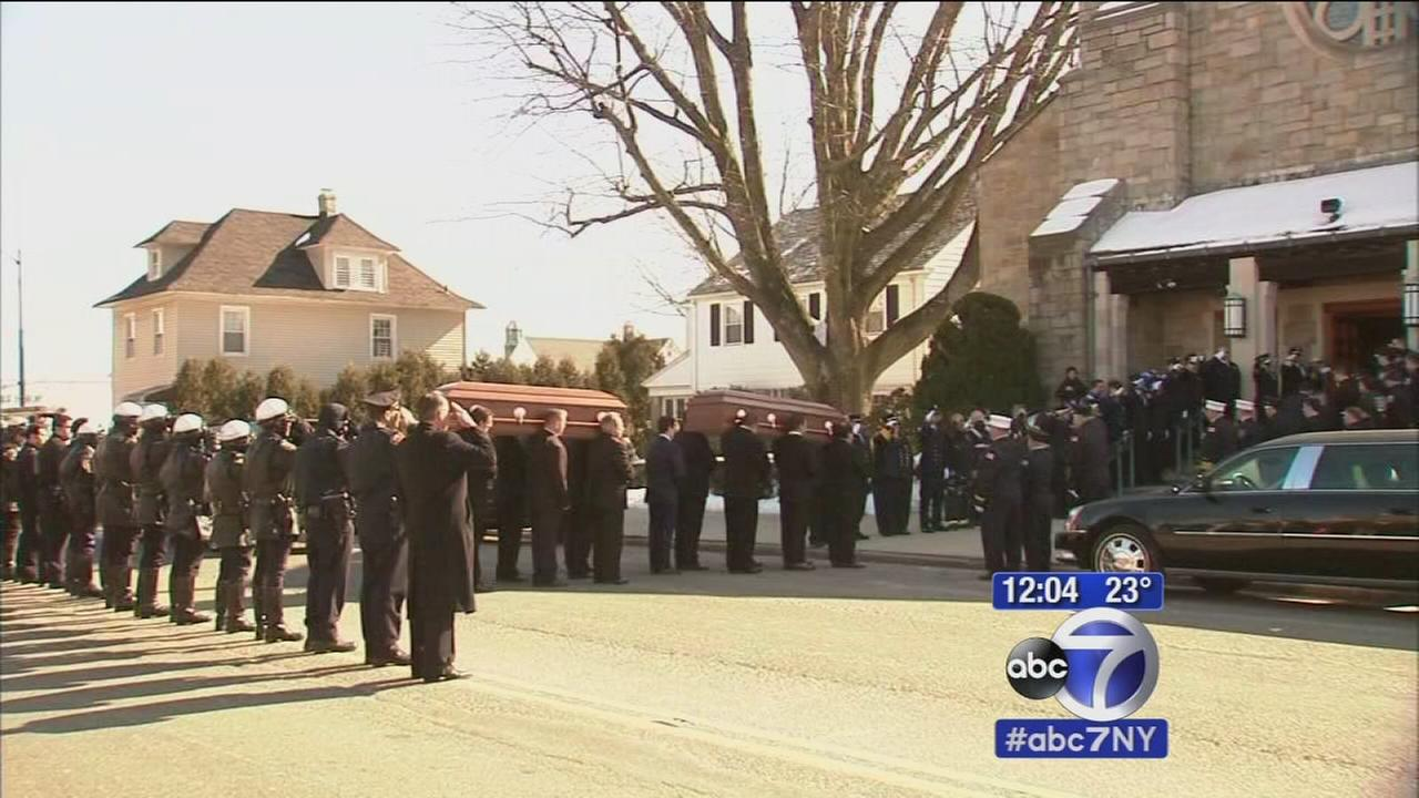 Daughters killed in murder, suicide laid to rest
