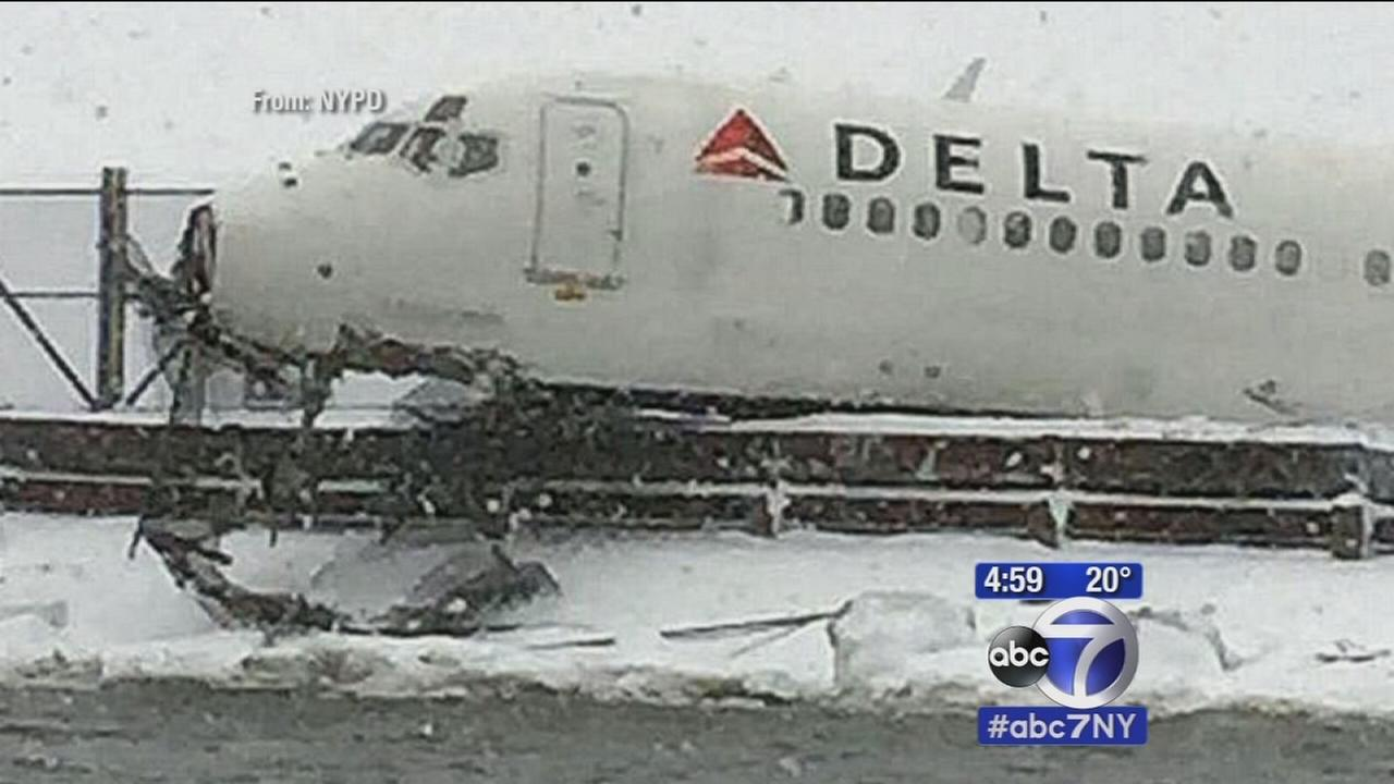 Plane skids off runway, into fence at LaGuardia