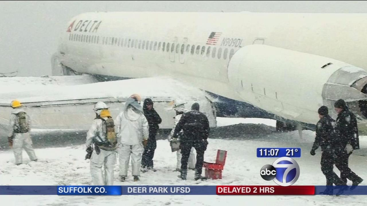 Delta plane skids off runway while landing at LaGuardia Airport