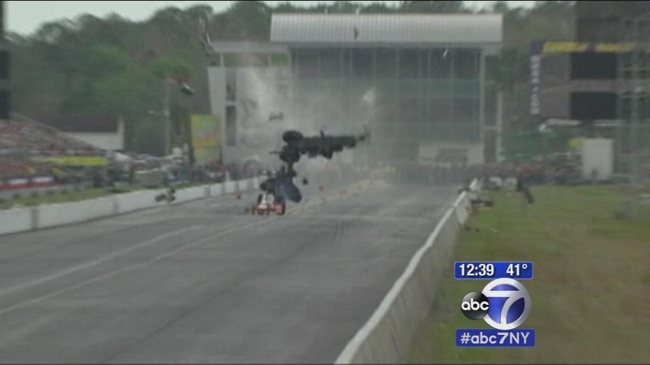 Wild crash at drag race track