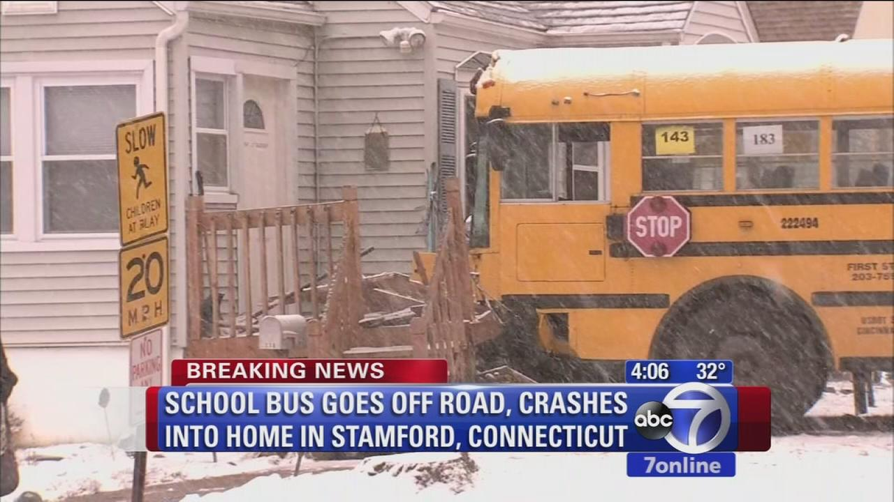 School bus crashes into home in Connecticut