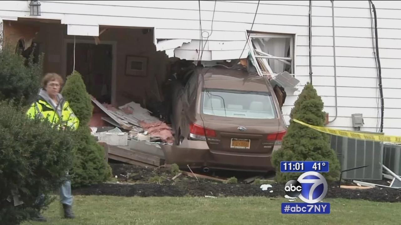 Car slams into Long Island house