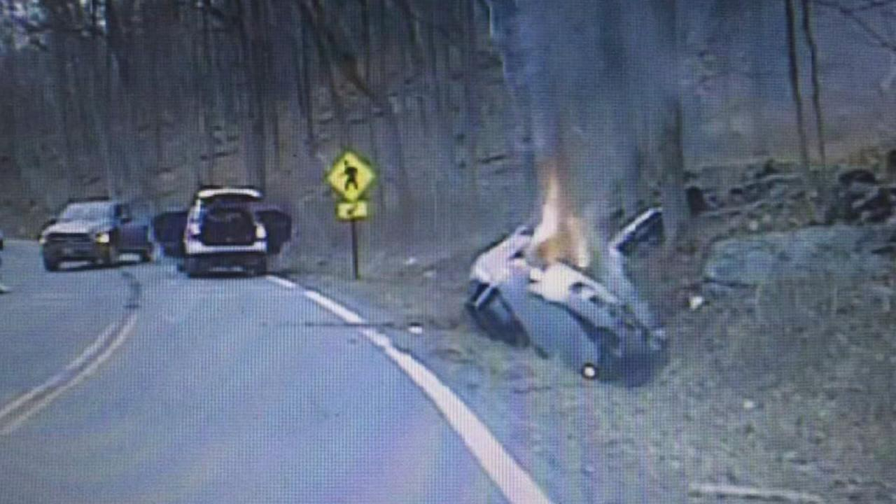 Police officers save woman from overturned car