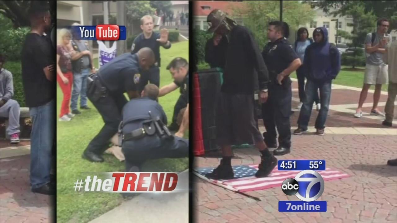 The Trend: Woman wrestles with police over American flag