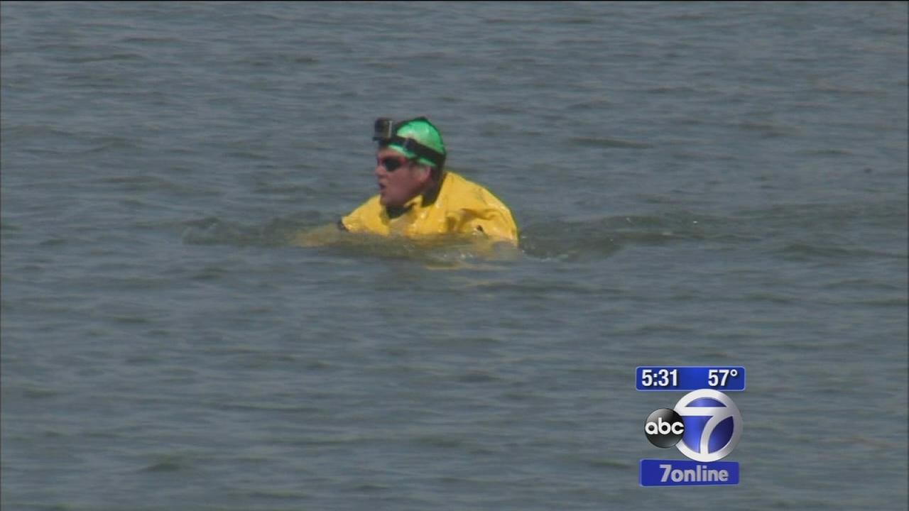 Man swims through polluted Gowanus Canal