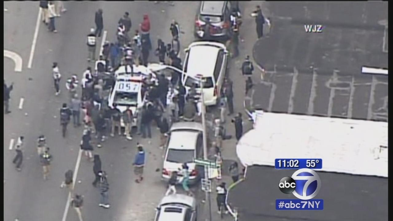Rioting erupts in Baltimore after funeral, National Guard activated