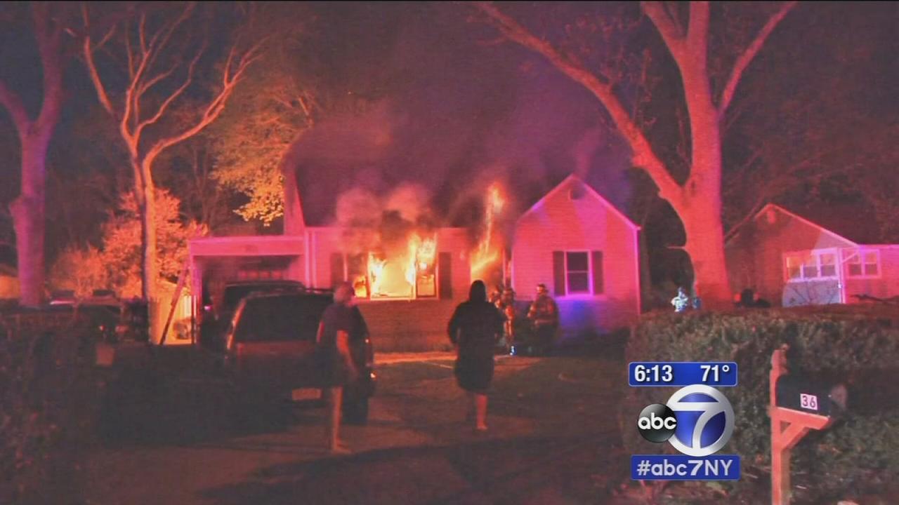 Good samaritan helps rescue woman from Centereach house fire