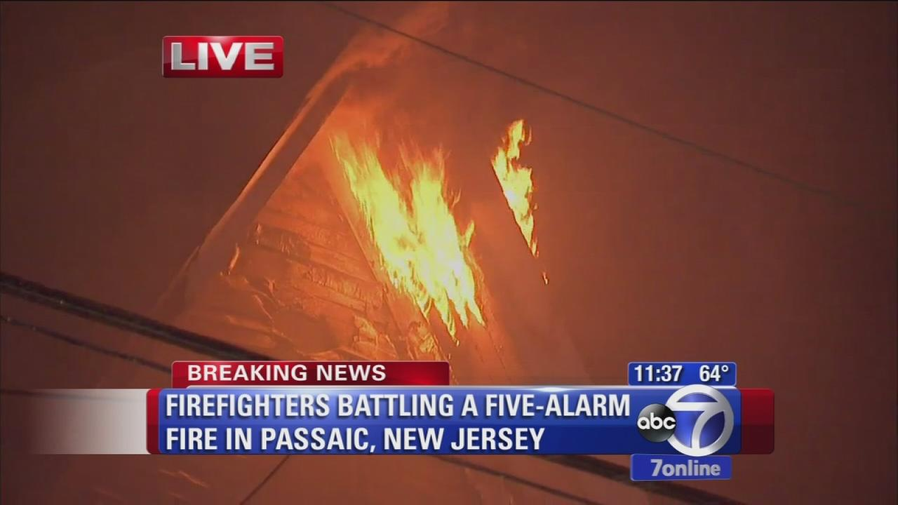 Firefighters battling 5-alarm fire in Passaic