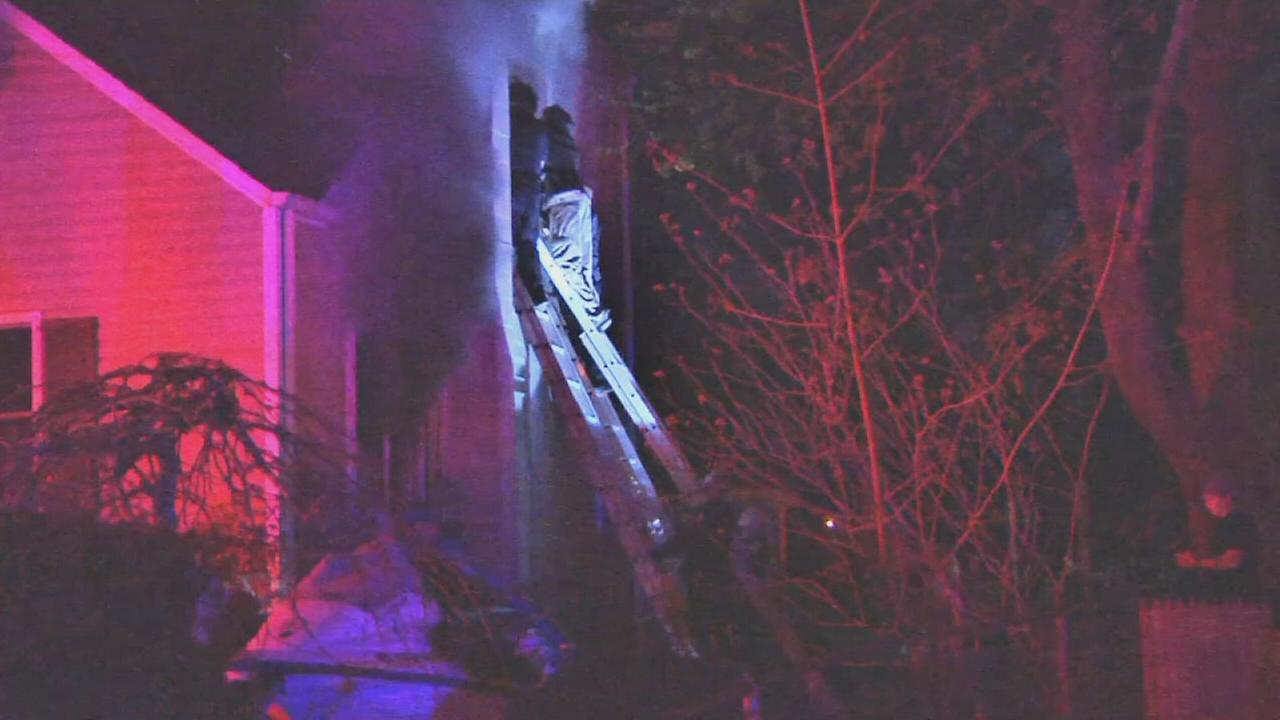 Woman rescued from Centereach house fire