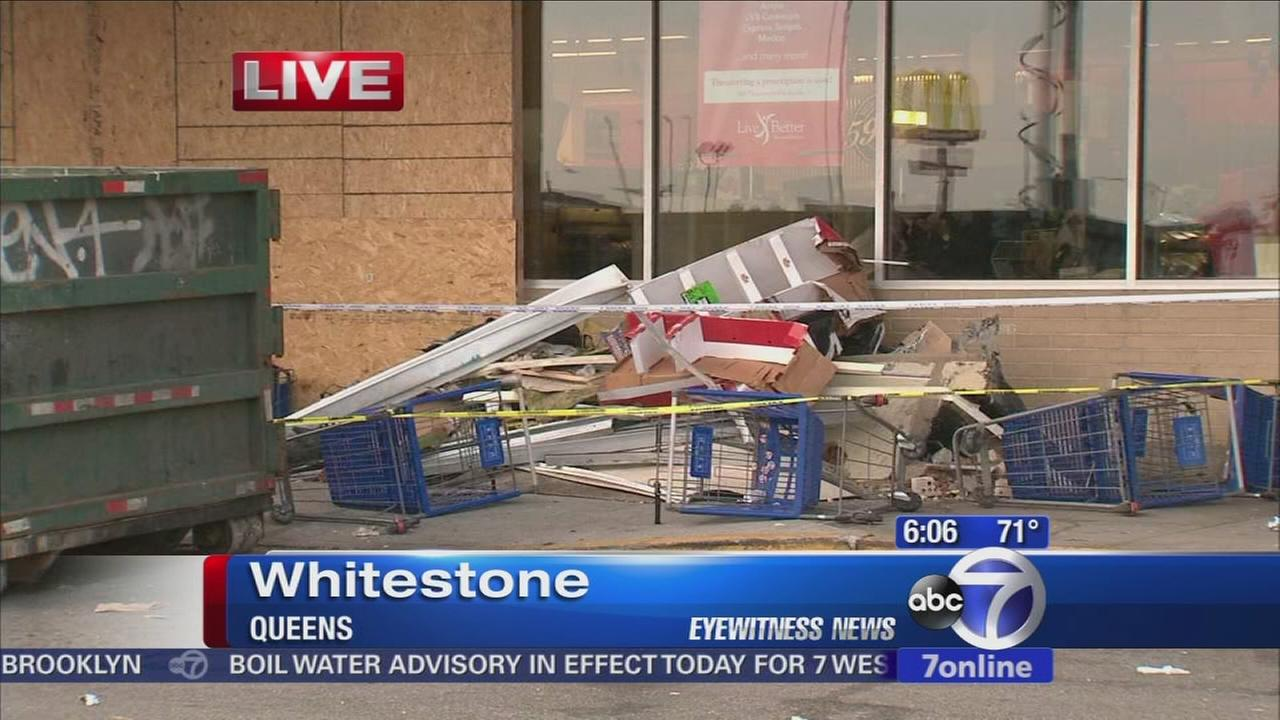 1 still serious after car crashes into Queens supermarket