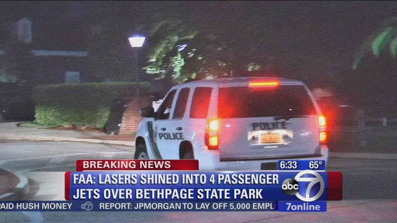 Four flights targeted with laser