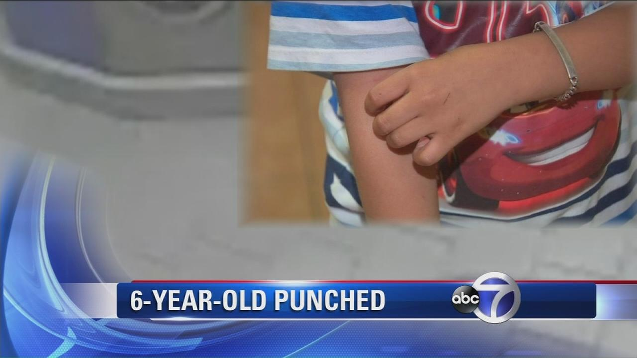 6-year-old punched while trying to protect mom during robbery