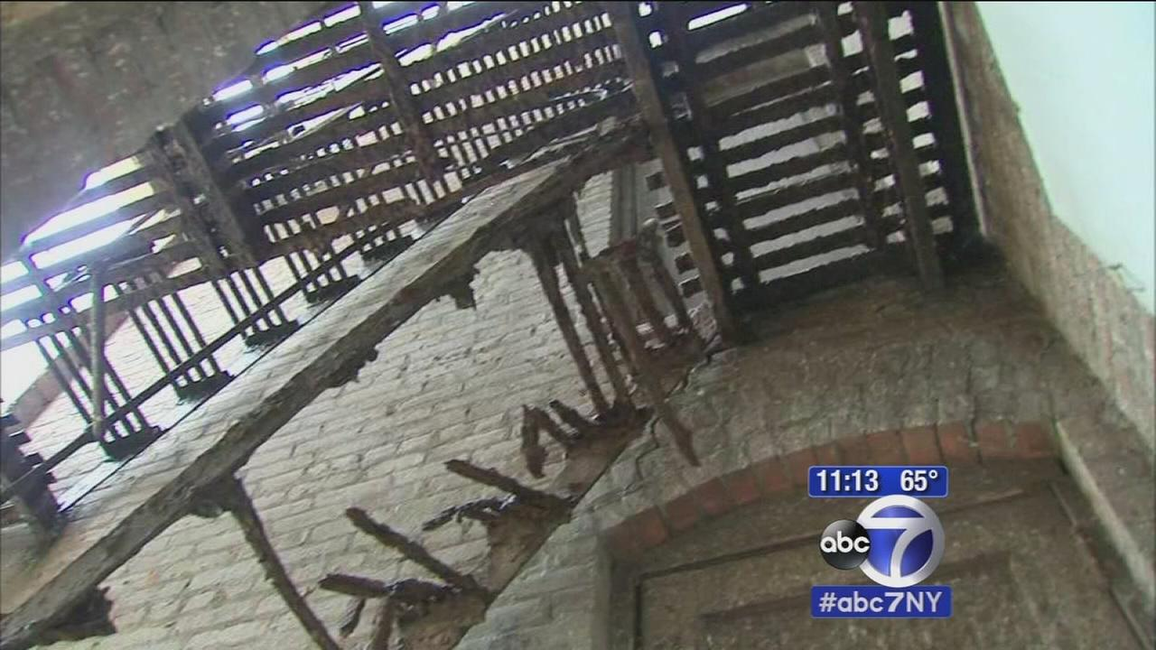 Man trying to escape fire crashes through fire escape stairs