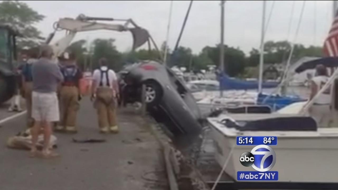 Man rescued after SUV lands in creek