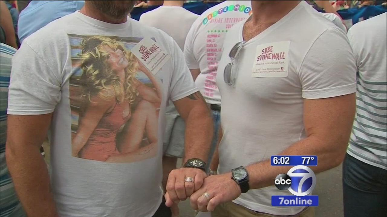 Crowds celebrating outside Stonewall Inn to celebrate historic gay marriage ruling