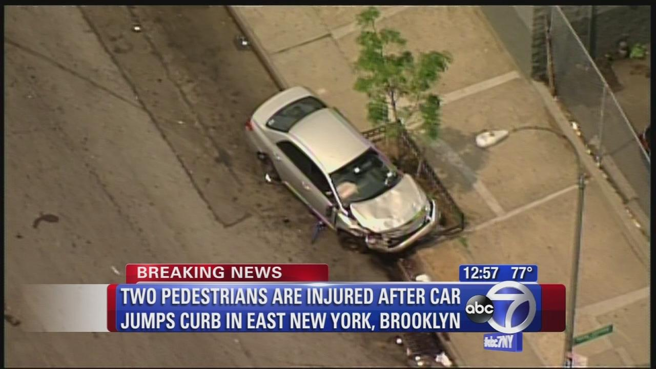 1 critical after car jumps curb in East New York