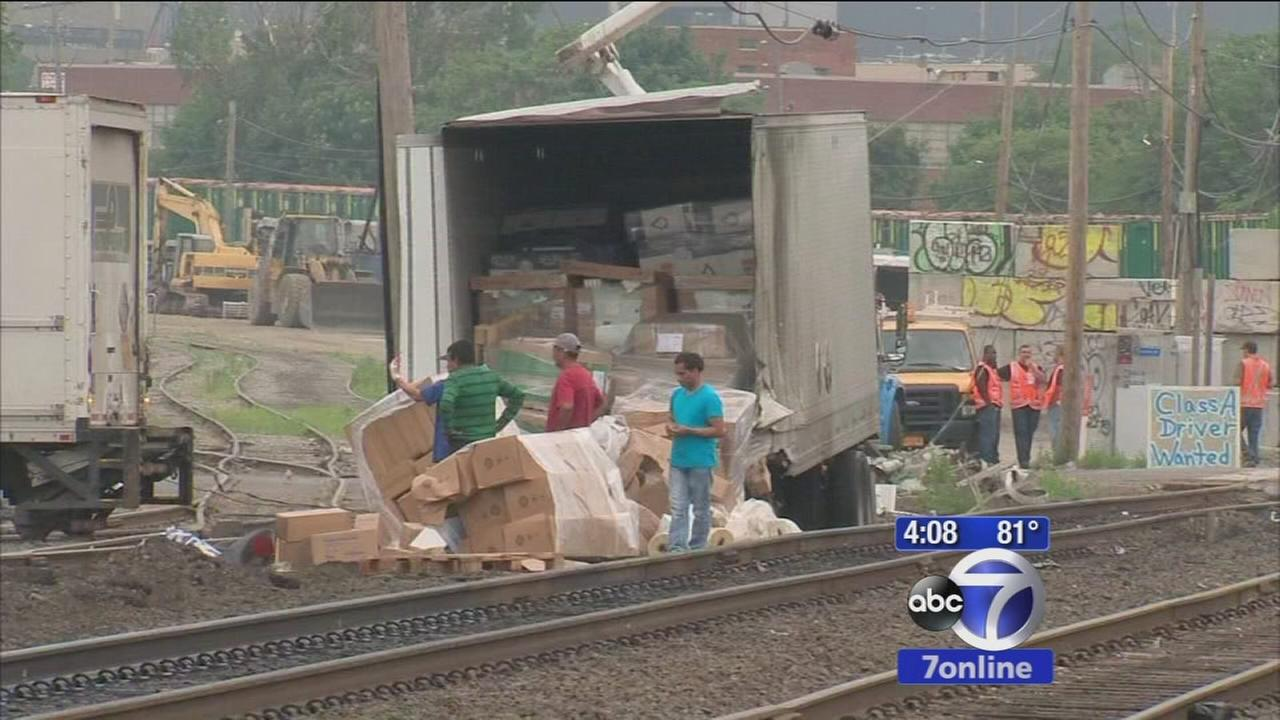 No one hurt after freight train crashes into tractor trailer
