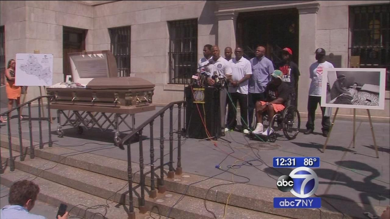 Brooklyn borough president calls for an end to gun violence, displays open casket as symbol