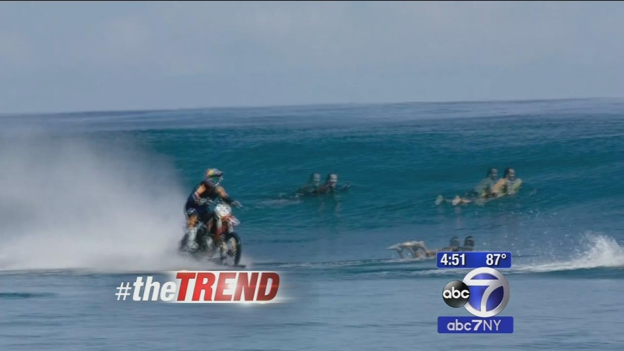 The Trend: Dirt biker rides over waves in Tahiti