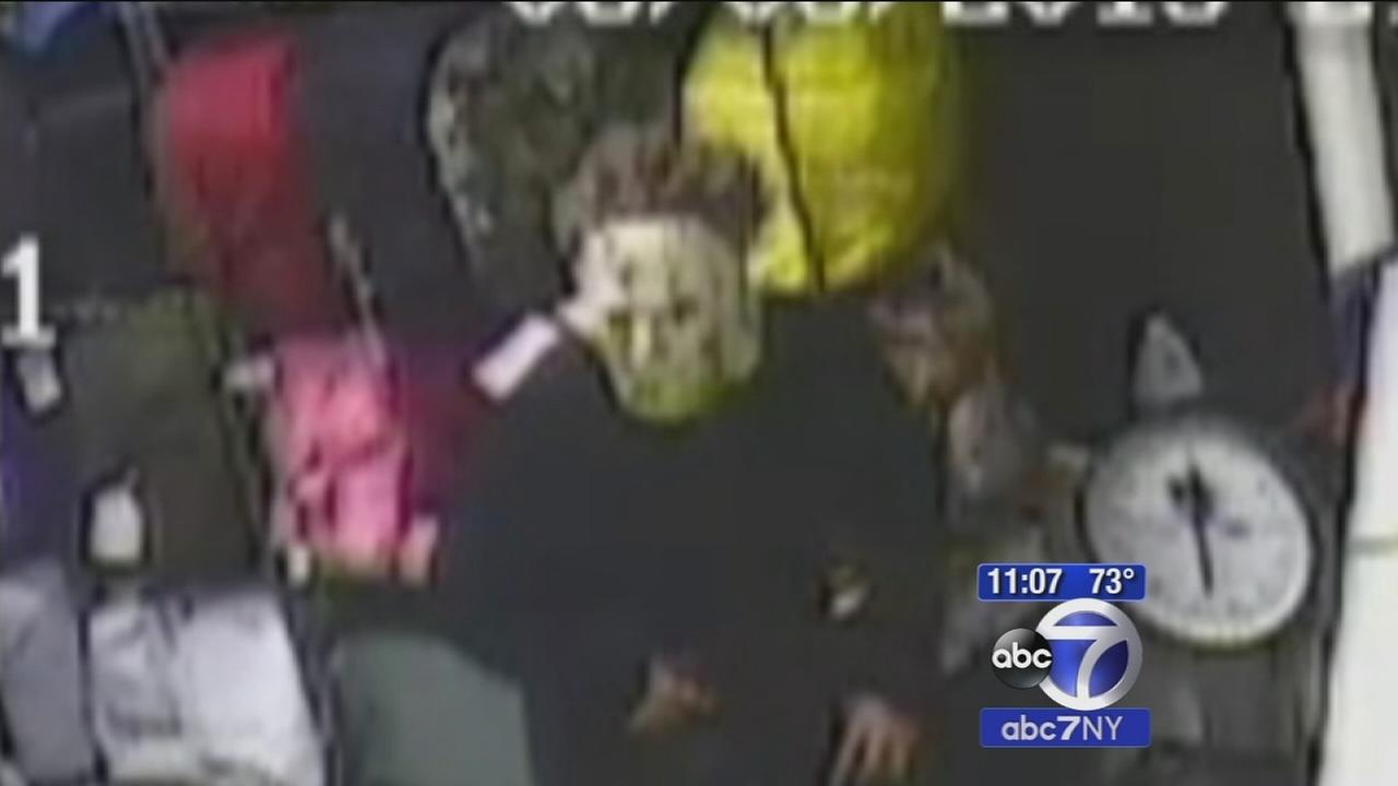 Suspect wearing Halloween mask caught on camera terrorizing victim during Laundromat robbery