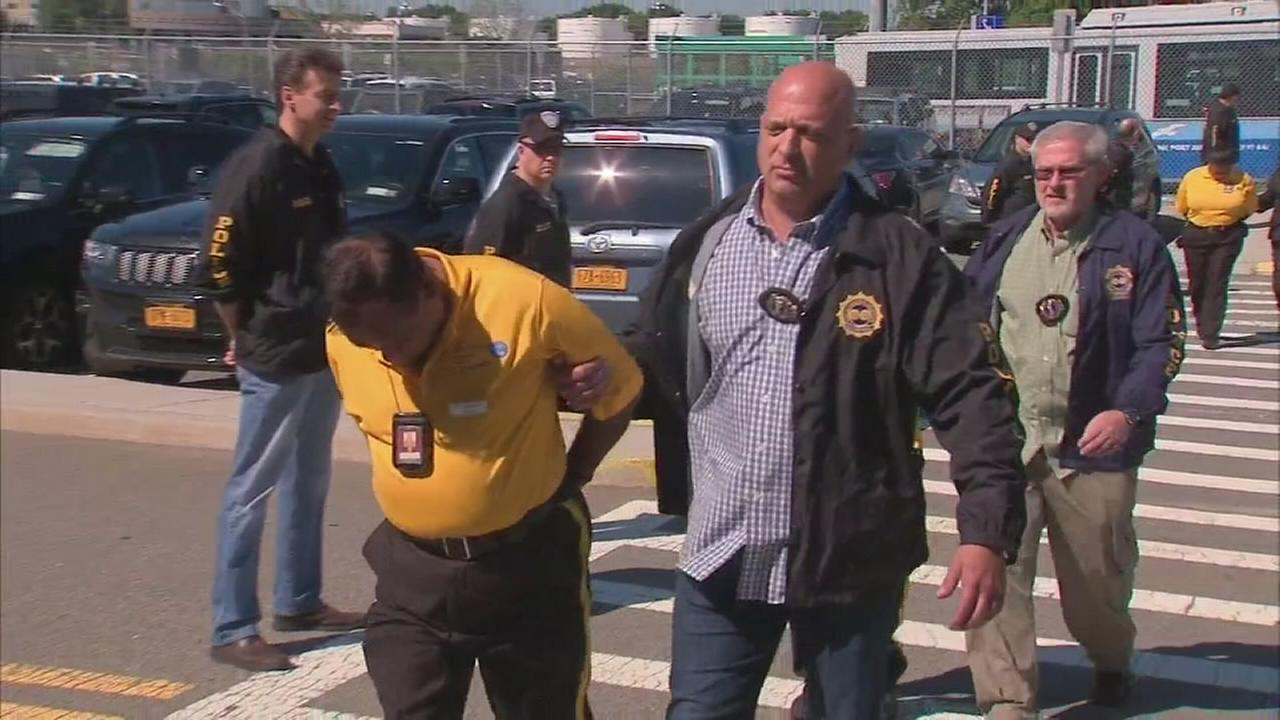 Raw video: Taxi dispatchers arrested