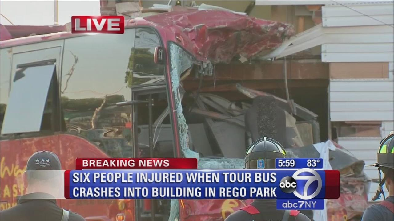 6 injured after bus crashes into building in Queens