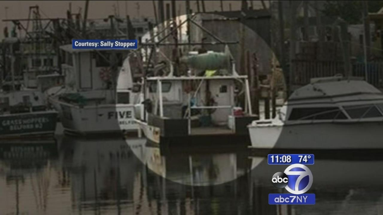 Search for missing fisherman after sunken boat located