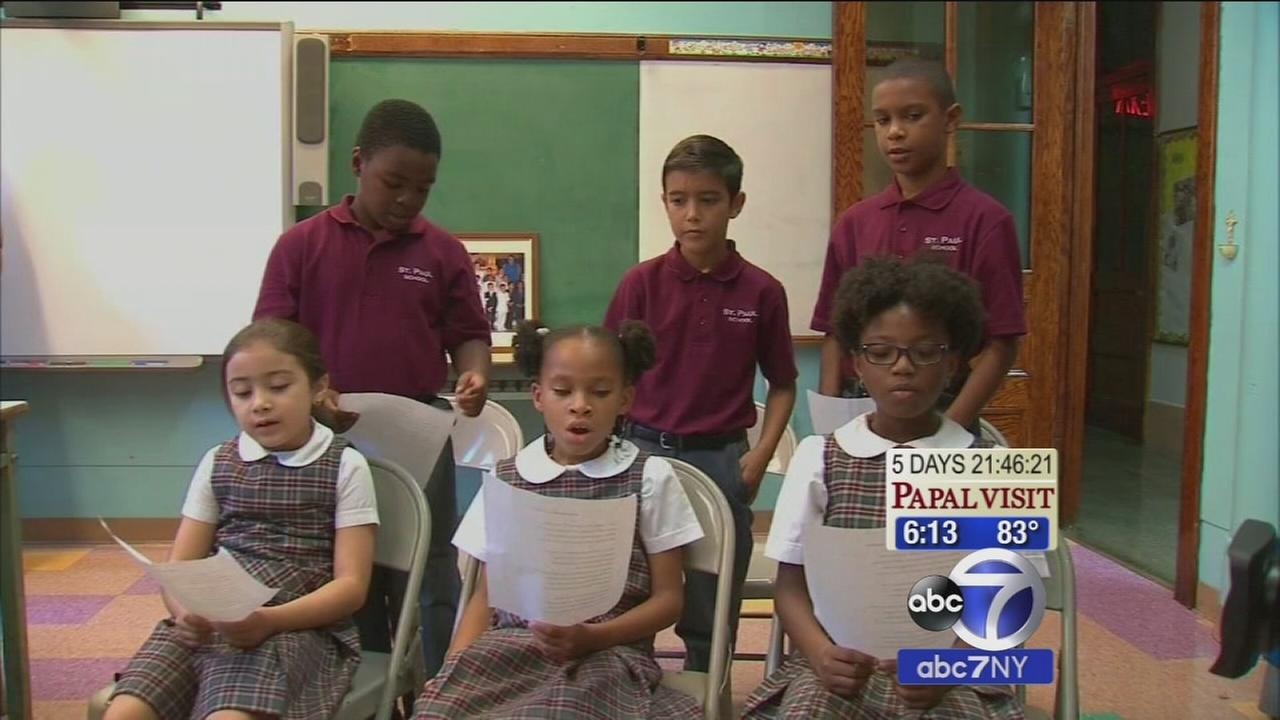 East Harlem students rehearse the song they will sing for Pope Francis